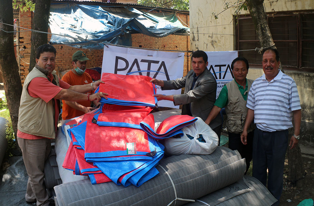 PATA Nepal Chapter Chairman also the Prseident of Explore Himalaya Mr. Suman Pandey hand over the relief materials to the victims representative